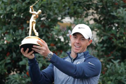 Rory McIlroy, of Northern Ireland, poses with the trophy after winning The Players Championship golf tournament Sunday, March 17, 2019, in Ponte Vedra Beach, Fla. (AP Photo/Gerald Herbert)