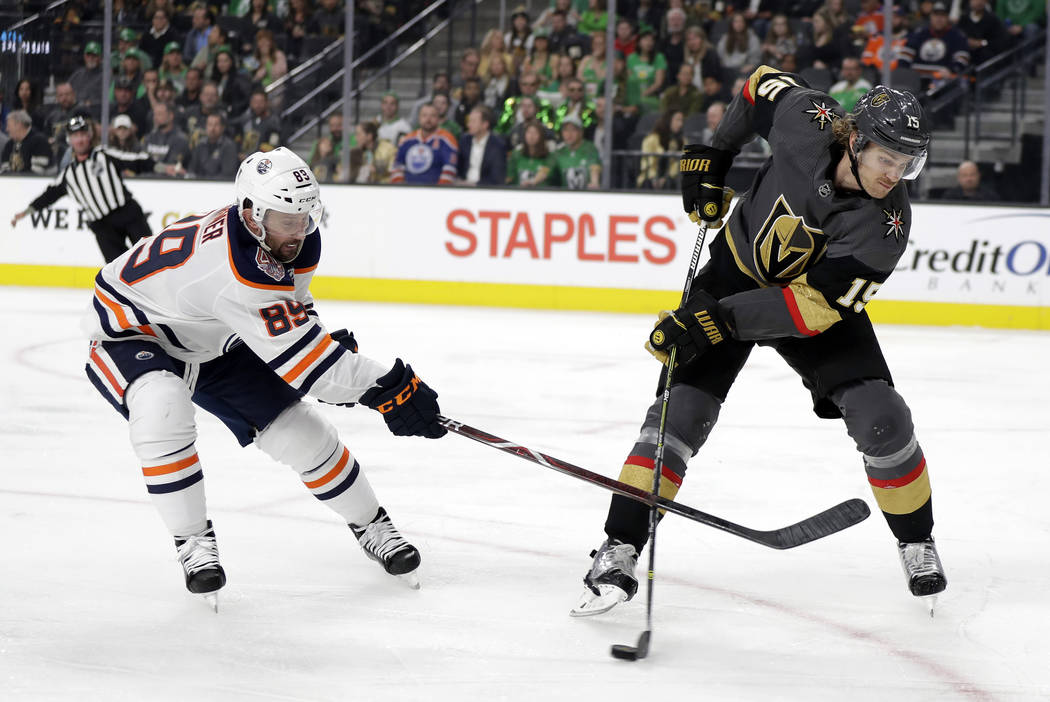 Edmonton Oilers left wing Sam Gagner (89) defends as Vegas Golden Knights right wing Reilly Smith passes the puck during the first period of an NHL hockey game Sunday, March 17, 2019, in Las Vegas ...
