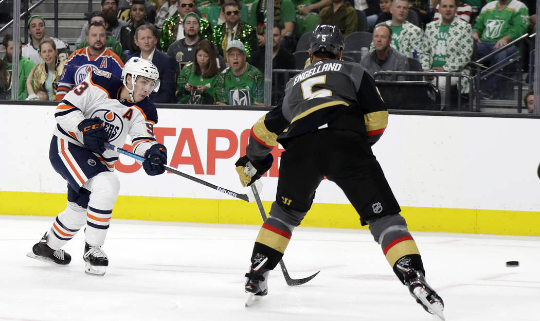 Edmonton Oilers center Ryan Nugent-Hopkins (93) takes a shot against the Vegas Golden Knights during the first period of an NHL hockey game Sunday, March 17, 2019, in Las Vegas. (AP Photo/Isaac Br ...