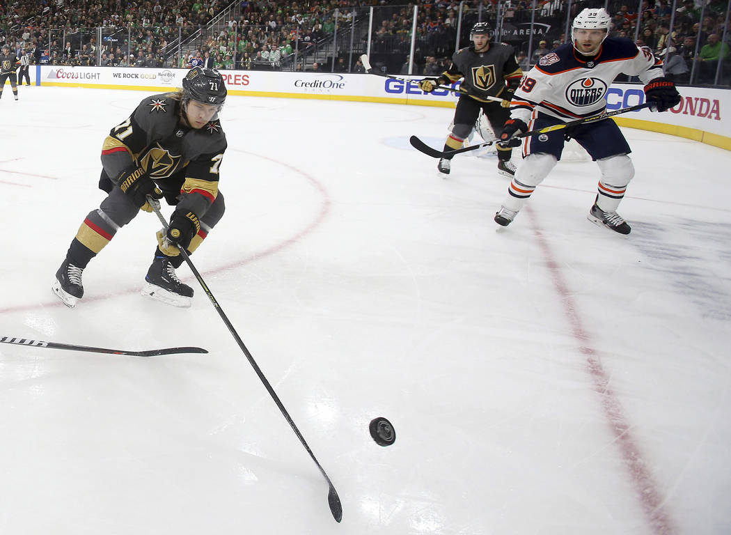 Vegas Golden Knights center William Karlsson (71) skates with the puck as Edmonton Oilers right wing Alex Chiasson defends during the first period of an NHL hockey game Sunday, March 17, 2019, in ...