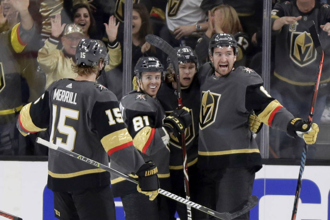 Vegas Golden Knights right wing Mark Stone, right, celebrates with teammates after scoring against the Edmonton Oilers during the first period of an NHL hockey game Sunday, March 17, 2019, in Las ...