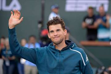 Dominic Thiem, of Austria, waves after defeating Roger Federer, of Switzerland, in the men's final at the BNP Paribas Open tennis tournament Sunday, March 17, 2019, in Indian Wells, Calif. Thiem w ...