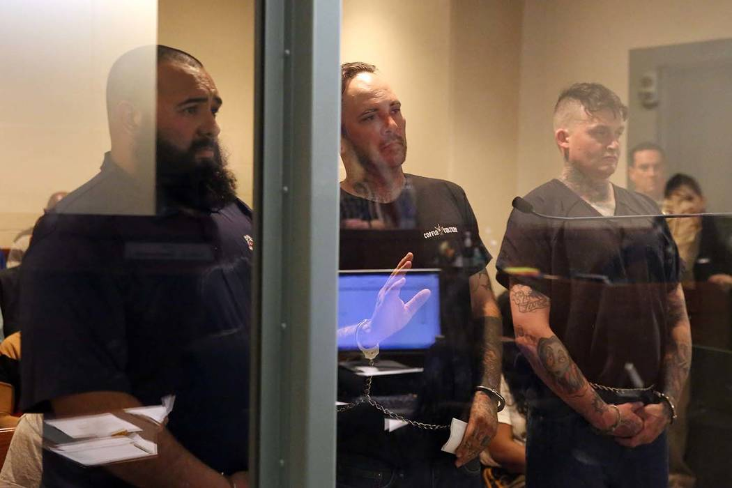 Roberto Romero, 30, left, Travis Callahan, 35, and Matthew Norris, 34, appear in court at the Regional Justice Center on Monday, March. 18, 2019, in Las Vegas. The three face several charges after ...