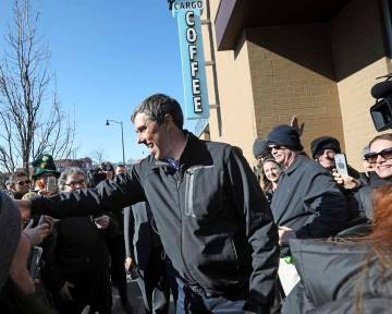 Democratic presidential candidate Beto O'Rourke greets a crowd outside Cargo Coffee on East Washington Avenue during a stop in Madison, Wis., Sunday, March 17, 2019. (AP Photo/Wisconsin State Jour ...