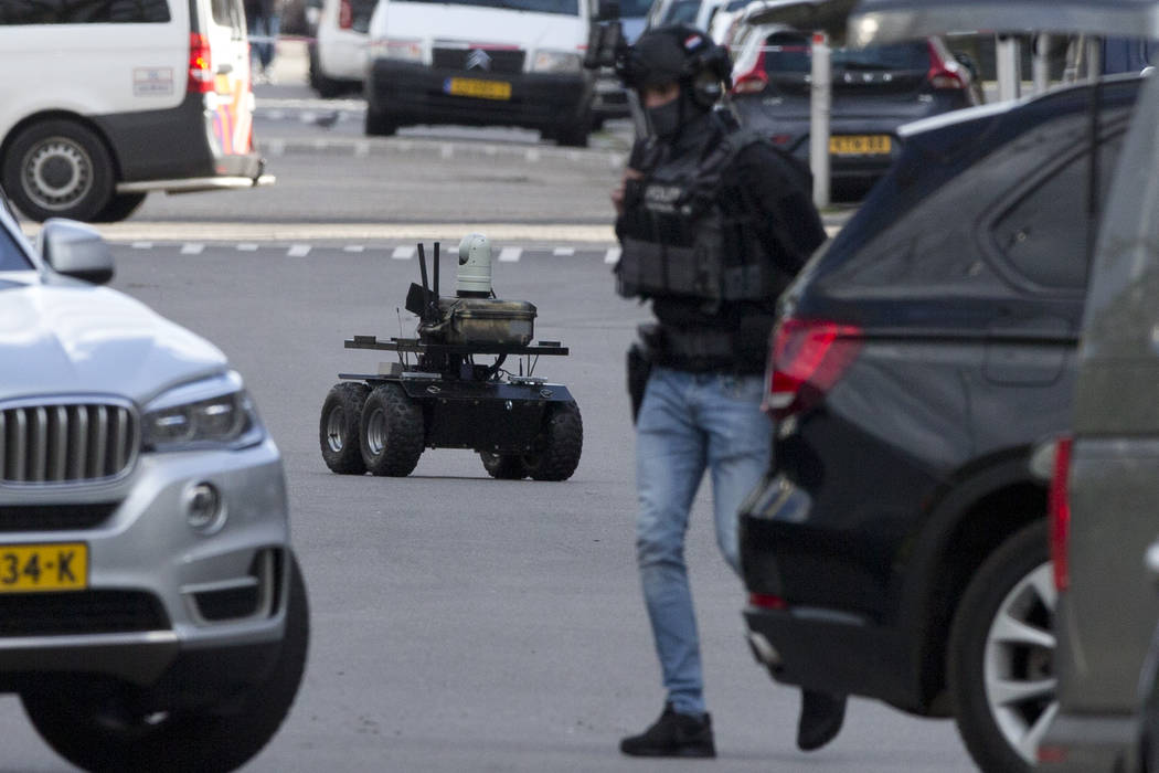Dutch counter terrorism police use a robot as they prepare to enter a house after a shooting incident in Utrecht, Netherlands, Monday, March 18, 2019. A gunman killed three people and wounded nine ...