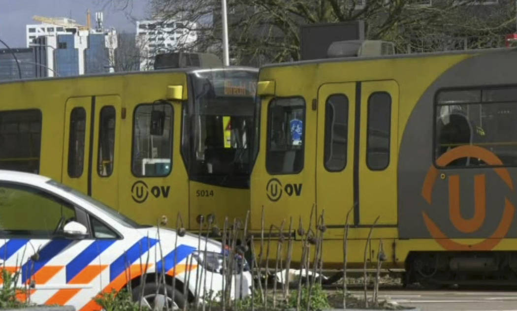 In this image taken from video, a body lays next to a tram as emergency services attend the scene of a shooting in Utrecht, Netherlands, Monday March 18, 2019. Police in the central Dutch city of ...