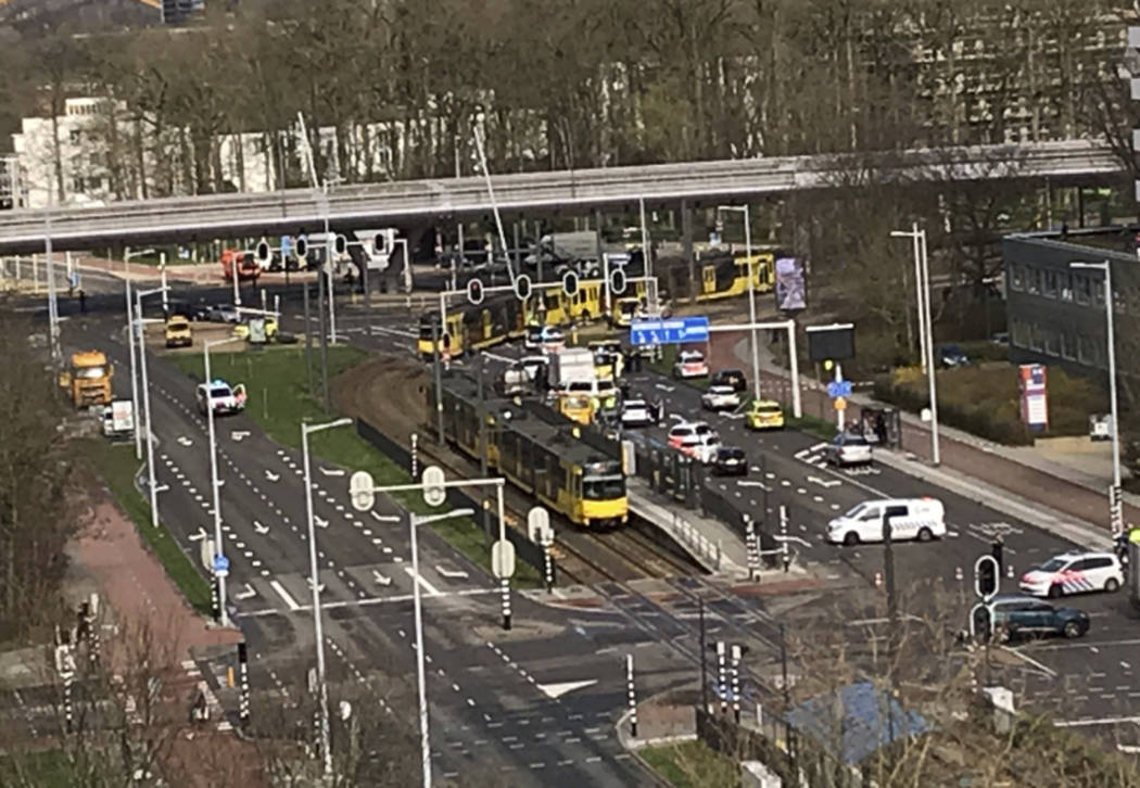 In this image taken from the Twitter page of Lilian Bruigom, emergency services attend the scene of a shooting in Utrecht, Netherlands, Monday March 18, 2019. Police in the central Dutch city of U ...