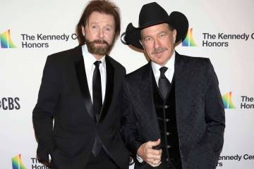 In this Dec. 2, 2018 file photo, Ronnie Dunn, left, and Kix Brooks attend the 41st Annual Kennedy Center Honors in Washington. Brooks & Dunn, comedic singer Ray Stevens and industry veteran Jerry ...