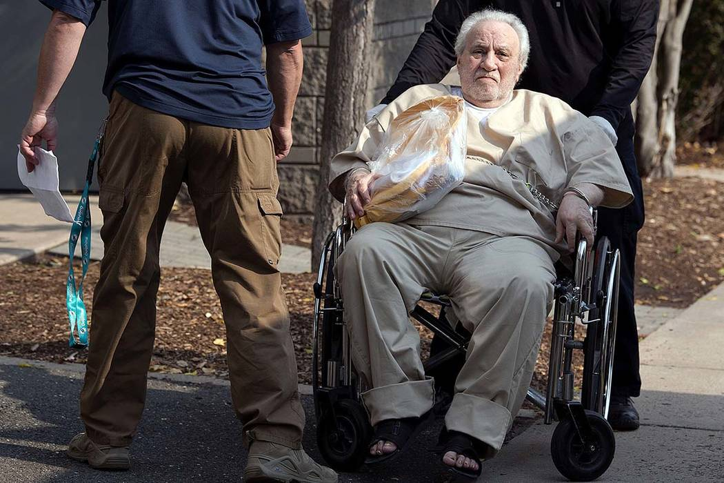 In this Sept. 5, 2017 file photo, Robert Gentile is wheeled into the federal courthouse in Hartford, Connecticut. (Patrick Raycraft/Hartford Courant via AP, File)