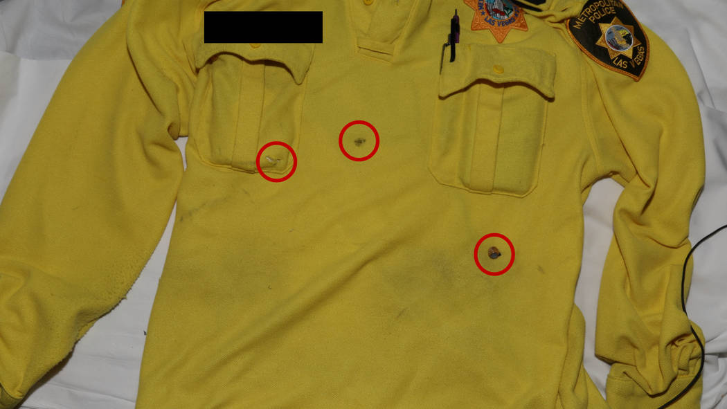 This photo released by the Las Vegas Metropolitan Police Department shows the shirt worn by a Las Vegas police officer who was shot following an armed robbery at the Bellagio hotel-casino on March ...