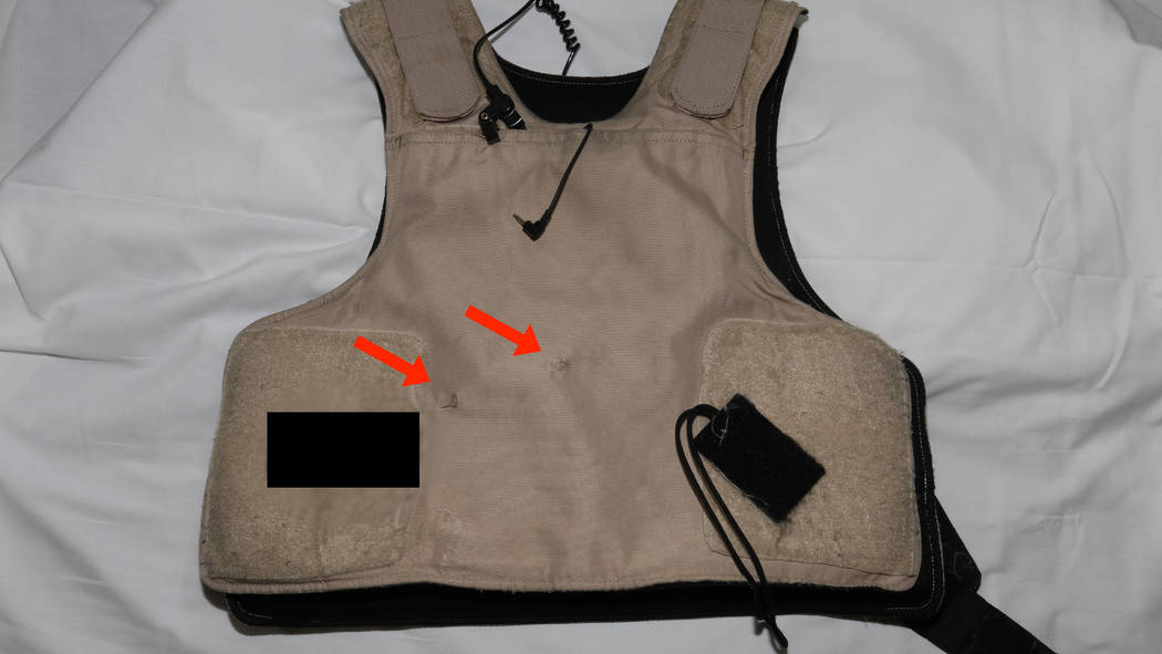 This photo released by the Las Vegas Metropolitan Police Department shows the bullet proof vest worn by a Las Vegas police officer who was shot following an armed robbery at the Bellagio hotel-cas ...