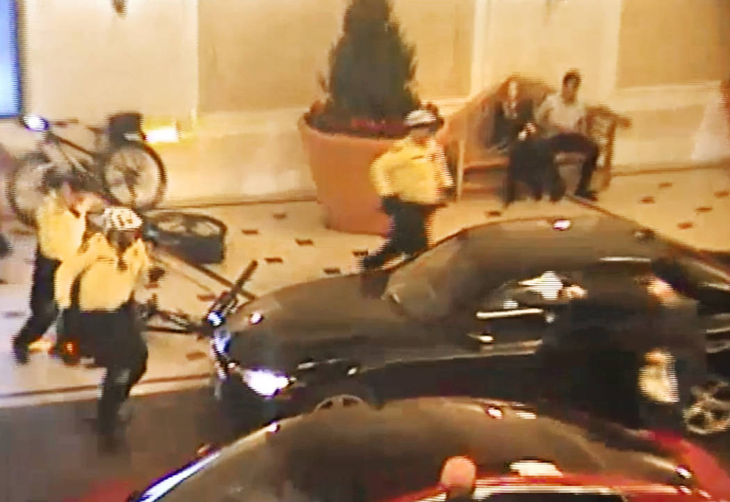 Michael Cohen, right, shoots at a Las Vegas Metropolitan Police Department officer following an armed robbery at the Bellagio hotel-casino on March 15, 2019. Cohen was shot to death by police foll ...