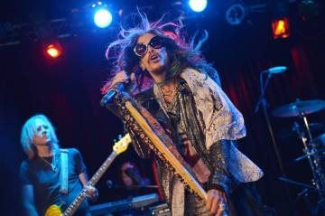 "Tom Hamilton, left, and Steven Tyler of Aerosmith perform at the Whisky A Go Go on Tuesday, April 8, 2014, in Los Angeles. Aerosmith announced their ""Let Rock Rule"" summer tour featuring Slash ..."