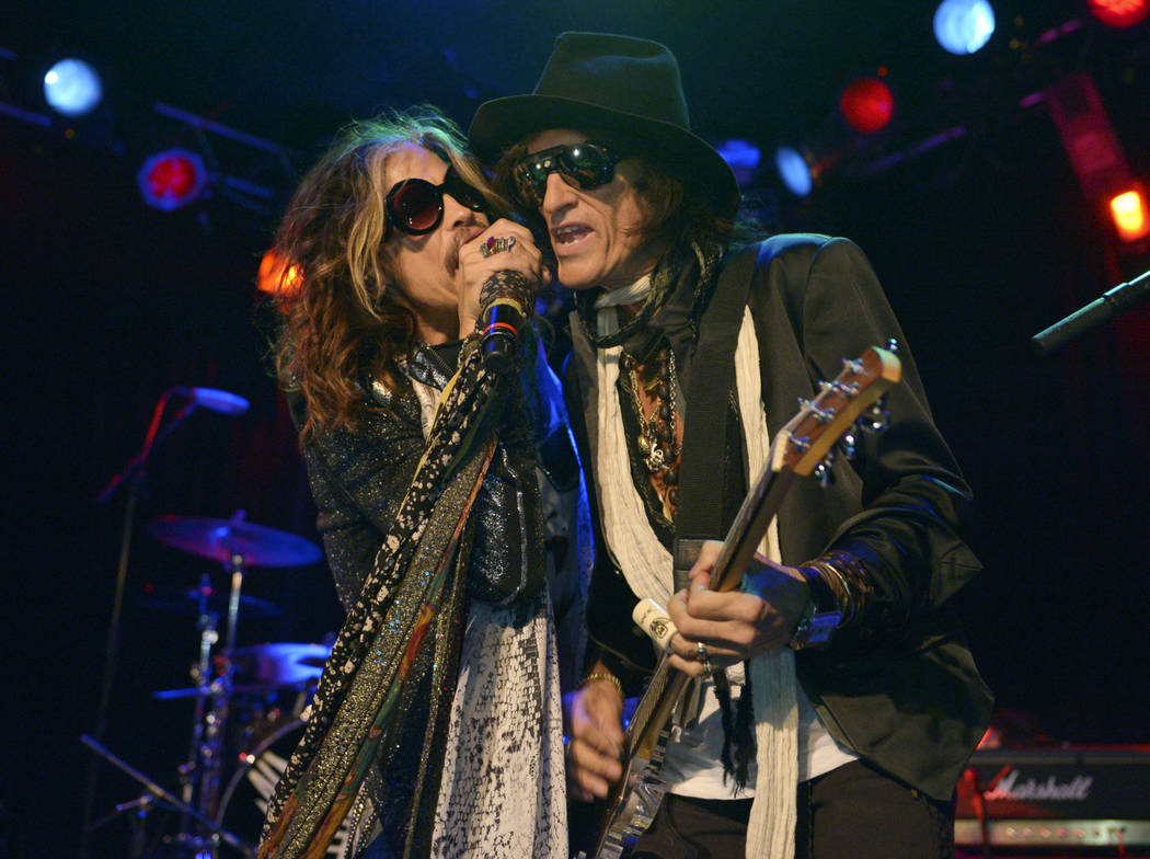 FILE - In this April 8, 2014 file photo, Steven Tyler, left, and Joe Perry of Aerosmith perform at the Whisky A Go Go in Los Angeles. Though others are canceling events and concerts after the ter ...