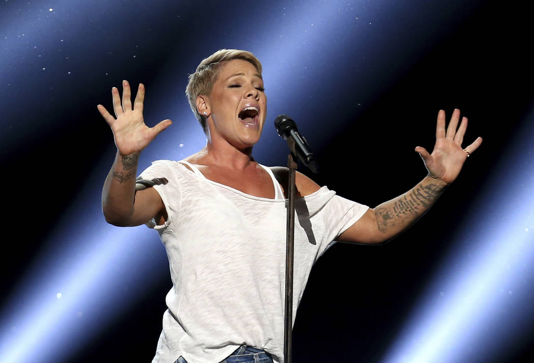 "Pink performs ""Wild Hearts Can't Be Broken"" at the 60th annual Grammy Awards at Madison Square Garden on Sunday, Jan. 28, 2018, in New York. (Photo by Matt Sayles/Invision/AP)"