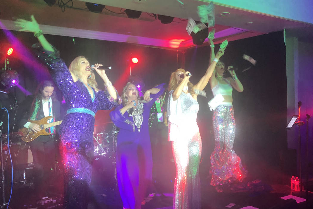 The ABBA-styled act featuring Kelly Clinton-Holmes, Kirbi Long, Ashley Fuller and Elisa Fiorillo is shown shown at the Stirling Club's re-opening party at Turnberry Place on Dec. 31, 2018. (John ...