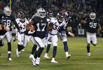 Oakland Raiders' Dwayne Harris (17) returns a punt for a touchdown against the Denver Broncos during the first half of an NFL football game in Oakland, Calif., Monday, Dec. 24, 2018. (AP Photo/D. ...