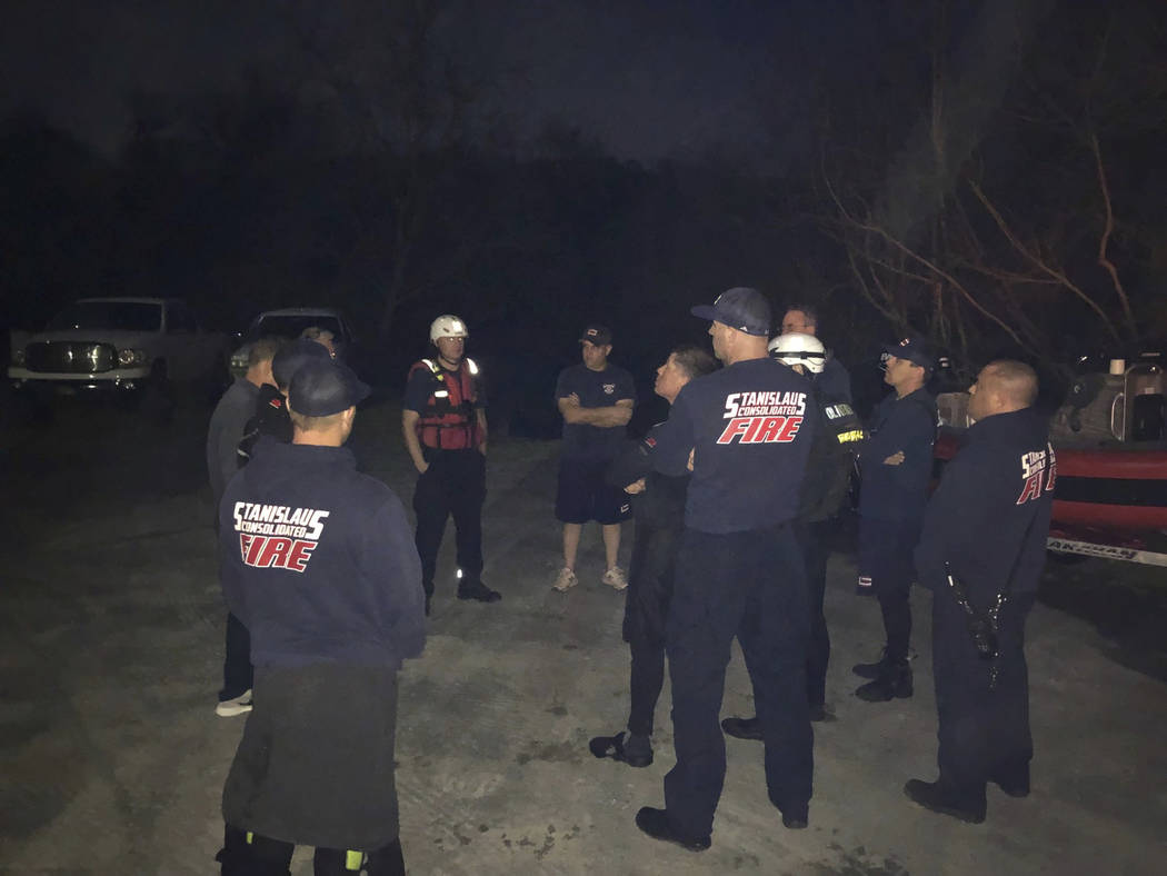 In this Sunday, March 17, 2019 photo provided by the Stanislaus Consolidated Fire Protection District Authorities fire and rescue personnel search for a 5-year-old girl who was swept away by a swo ...