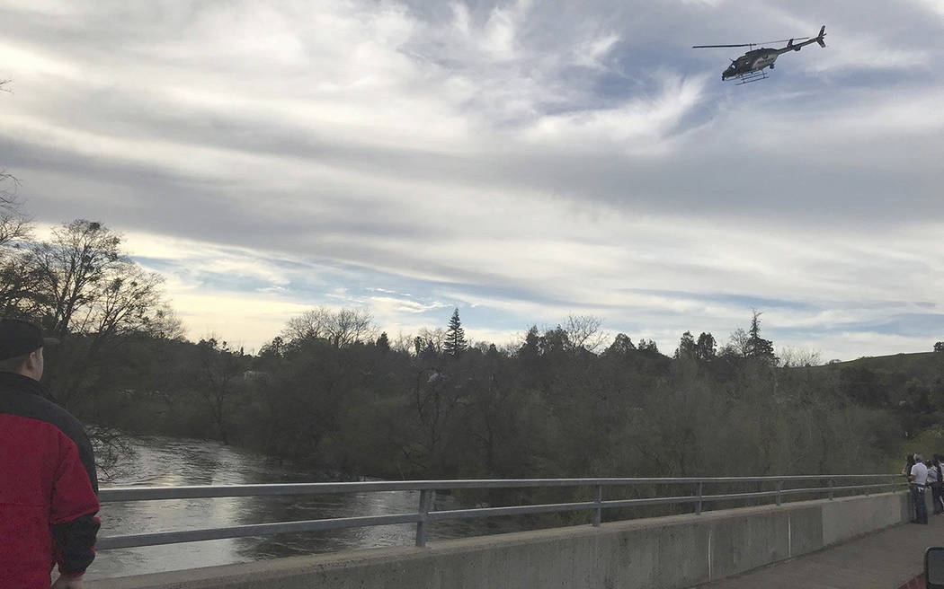 In this Sunday, March 17, 2019 photo provided by the Stanislaus Consolidated Fire Protection District Authorities, fire and rescue personnel search for a 5-year-old girl who was swept away by a sw ...