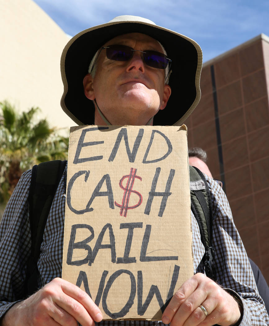 William O'Connell holds a sign outside of the Grant Sawyer Building as he protests to promote criminal justice reform on Monday, March 18, 2019, in Las Vegas. Bizuayehu Tesfaye Las Vegas Review-Jo ...
