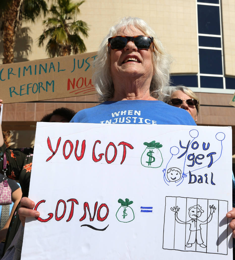 Gayanne Fried holds a sign outside of the Grant Sawyer Building as she protests to promote criminal justice reform on Monday, March 18, 2019, in Las Vegas. Bizuayehu Tesfaye Las Vegas Review-Journ ...