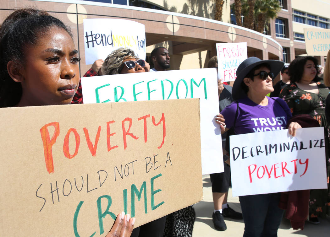 Protesters, including Sierra Bumanglag, rally to promote criminal justice reform outside of the Grant Sawyer Building on Monday, March 18, 2019, in Las Vegas. Bizuayehu Tesfaye Las Vegas Review-Jo ...
