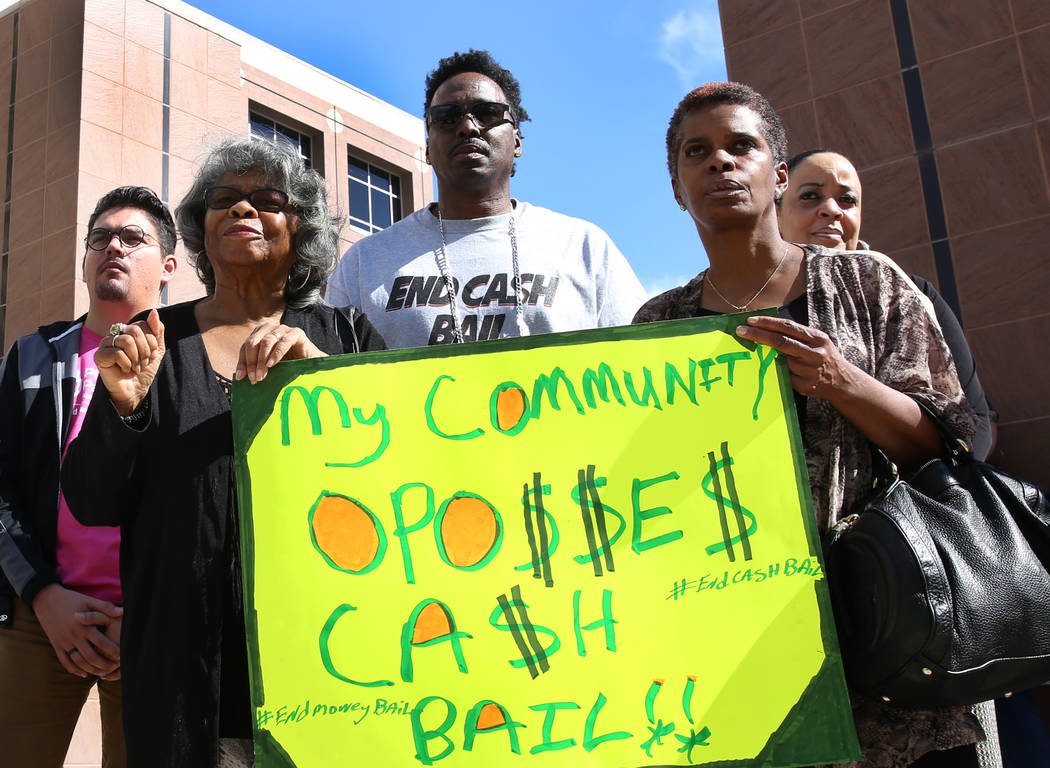 Lanese Kelsey, left, Robert Strawder and Kathy Ward, right, rally to promote criminal justice reform outside of the Grant Sawyer Building on Monday, March 18, 2019, in Las Vegas. (Bizuayehu Tesfa ...