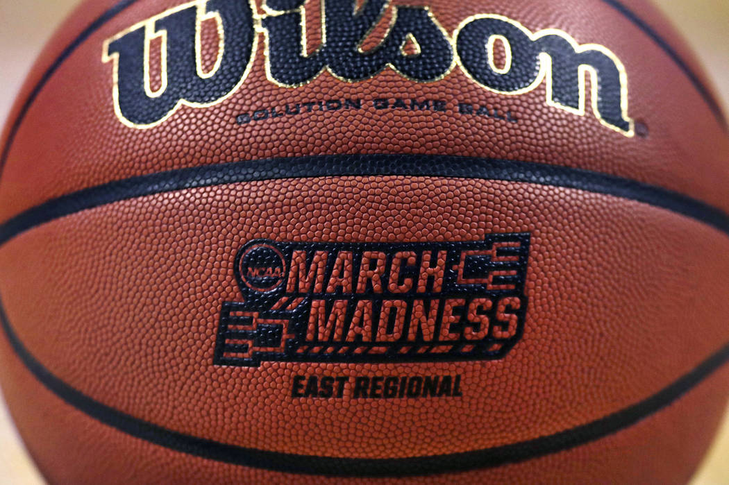 """The """"March Madness"""" logo adorns a ball resting on the court during practice at the NCAA men's college basketball tournament in Boston, Thursday, March 22, 2018. (AP Photo/Charles Krupa)"""