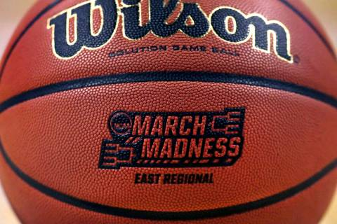 "The ""March Madness"" logo adorns a ball resting on the court during practice at the NCAA men's college basketball tournament in Boston, March 22, 2018. (Charles Krupa/AP)"