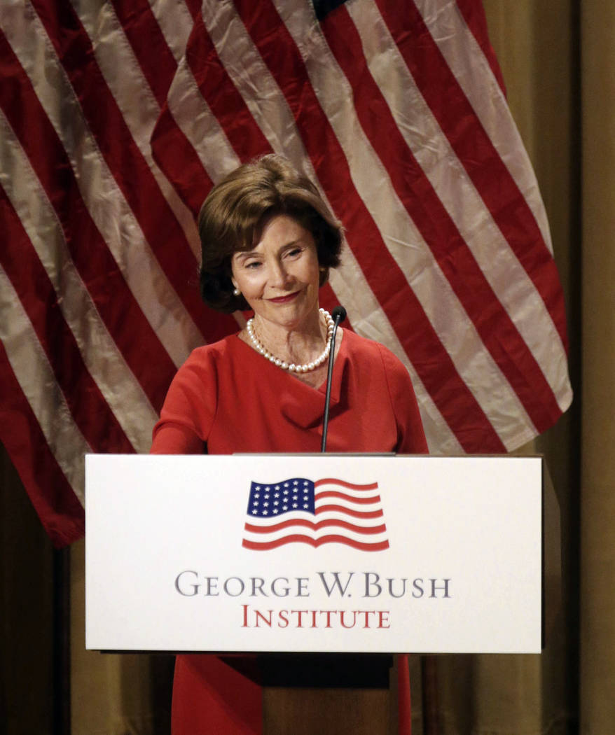 Former first lady Laura Bush gives remarks during a naturalization ceremony at the George W. Bush Presidential Center in Dallas on Monday, March 18, 2019. Before the naturalization ceremony, Presi ...