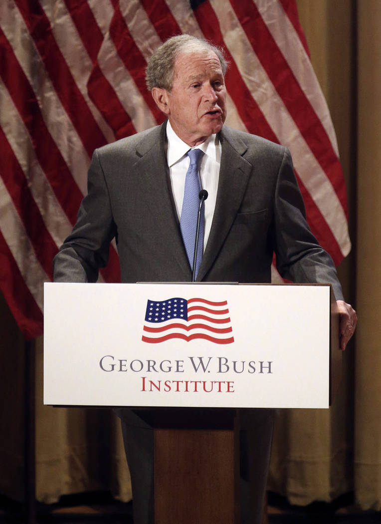 Former President George W. Bush gives remarks on immigration during a naturalization ceremony at the George W. Bush Presidential Center in Dallas on Monday, March 18, 2019. Before the naturalizati ...