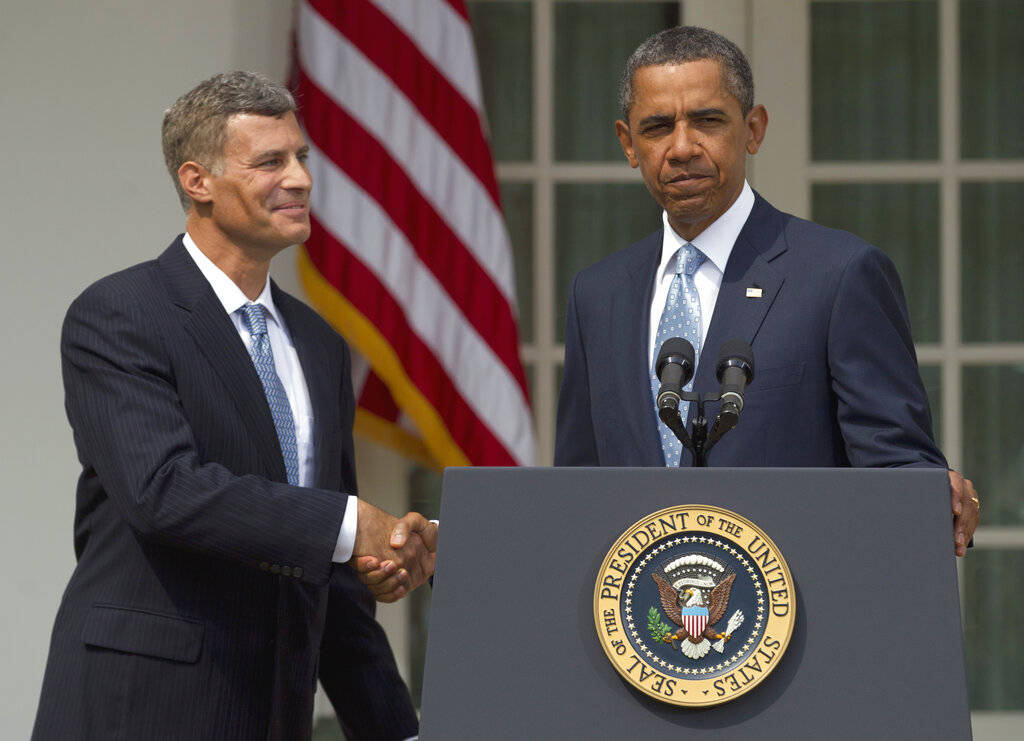 In this Aug. 29, 2011, file photo President Barack Obama shakes hands with Alan Krueger, left, as he announces him as chairman of the Council of Economic Advisers in the Rose Garden of the White H ...