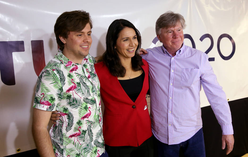 Presidential hopeful U.S. Rep. Tulsi Gabbard, D-Hawaii, center, Lucas Stephen, left, and his father, Reilly Stephen, during a meet and greet at the Asian Culture Center in downtown Las Vegas Monda ...
