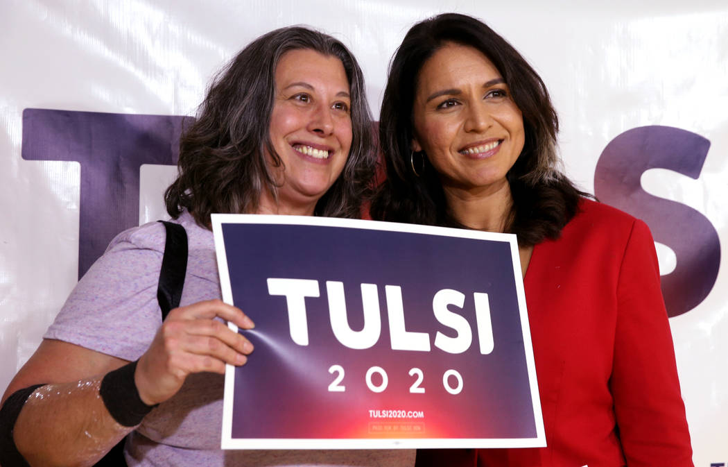 Presidential hopeful U.S. Rep. Tulsi Gabbard, D-Hawaii, right, with Shelly O'Connor of Las Vegas during a meet and greet at the Asian Culture Center in downtown Las Vegas Monday, March 18, 2019. ( ...
