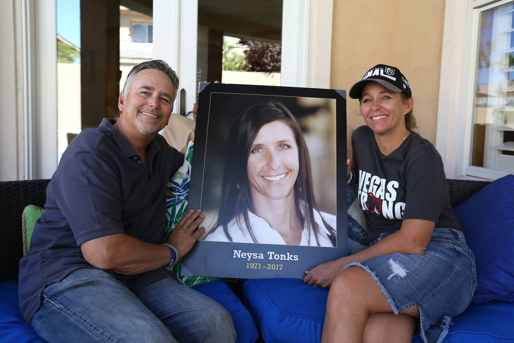 Chris Davis, father of Route 91 Harvest festival shooting victim Neysa Tonks, and his daughter Mynda Smith pose with a photograph of Tonks on Wednesday, Sept. 26, 2018, in Las Vegas. (Bizuayehu Te ...