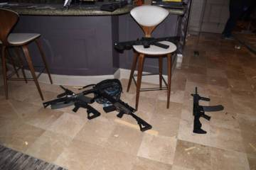 Guns are shown in the Mandalay Bay suite of Stephen Paddock after the Oct. 1, 2017, mass shooting in Las Vegas. (Las Vegas Metropolitan Police Department)