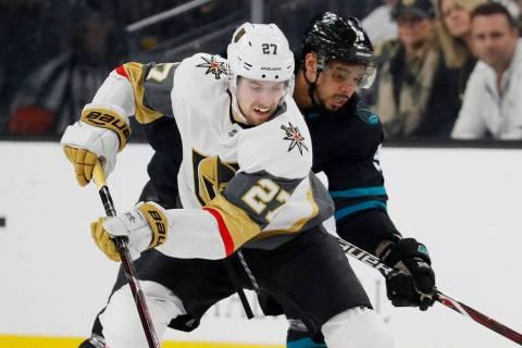 Vegas Golden Knights defenseman Shea Theodore (27) skates around San Jose Sharks left wing Evander Kane during the first period of an NHL hockey game Thursday, Jan. 10, 2019, in Las Vegas. (AP Pho ...