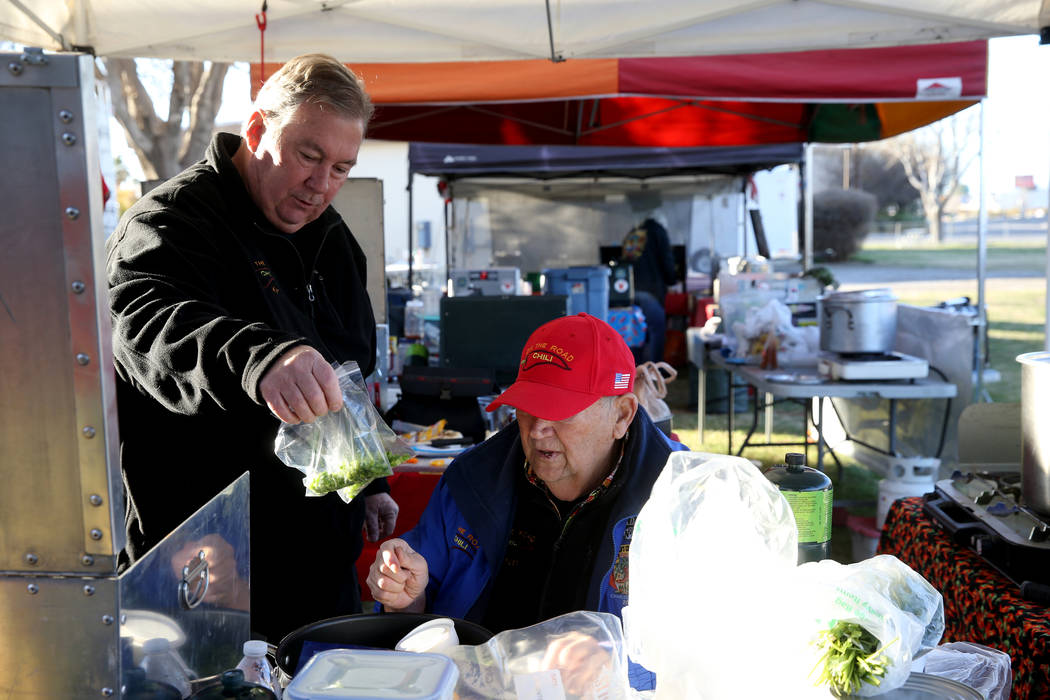 Ken Hook and Chuck Harber, of Corona, California, collaborate with ingredients for their competition chili at the Nevada State Chili Cook-off at Petrack Park in Pahrump Sunday, March 17, 2019. (K. ...