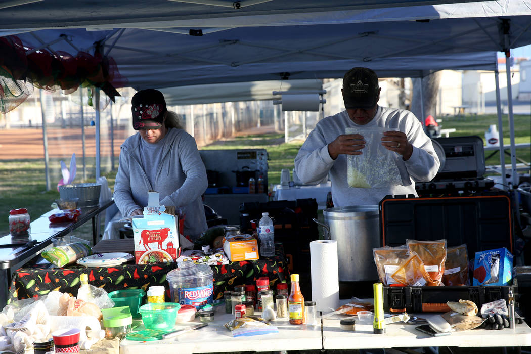 Husband and wife team of Connie and Brian Anthony of Laughlin prepare their competition chili and sample condoments at their booth at the Nevada State Chili Cook-off at Petrack Park in Pahrump Sun ...