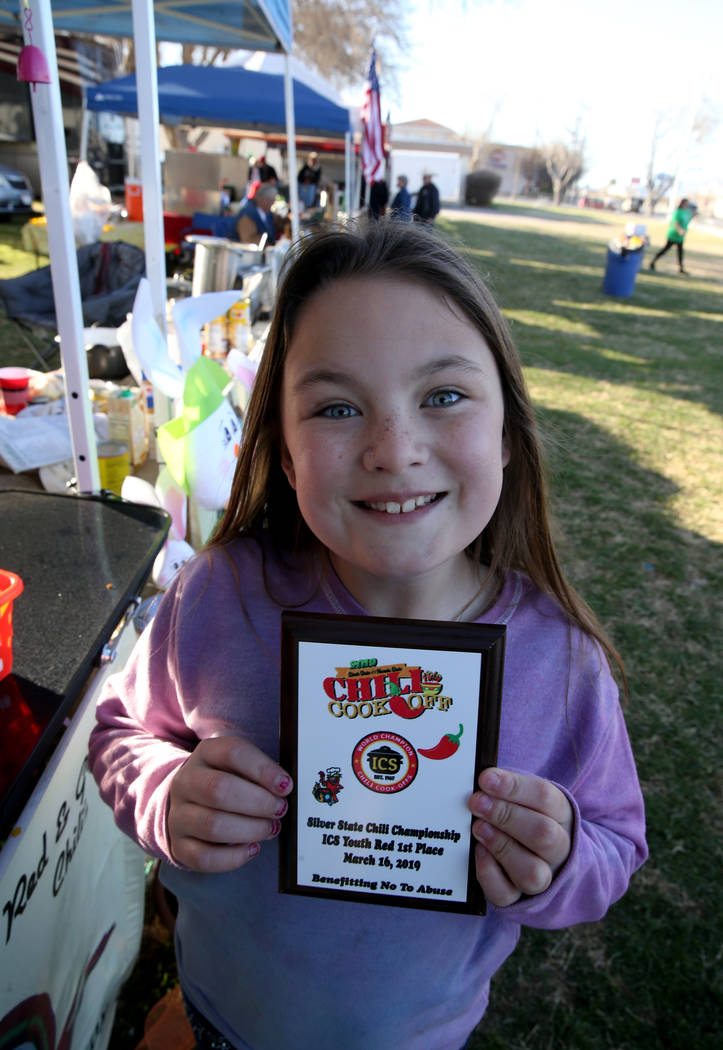 Ily Anthony, 10, of Laughlin shows her award for winning the Silver State Chili Championship Youth Red category the previous day while supporting her parents competing in the Nevada State Chili Co ...