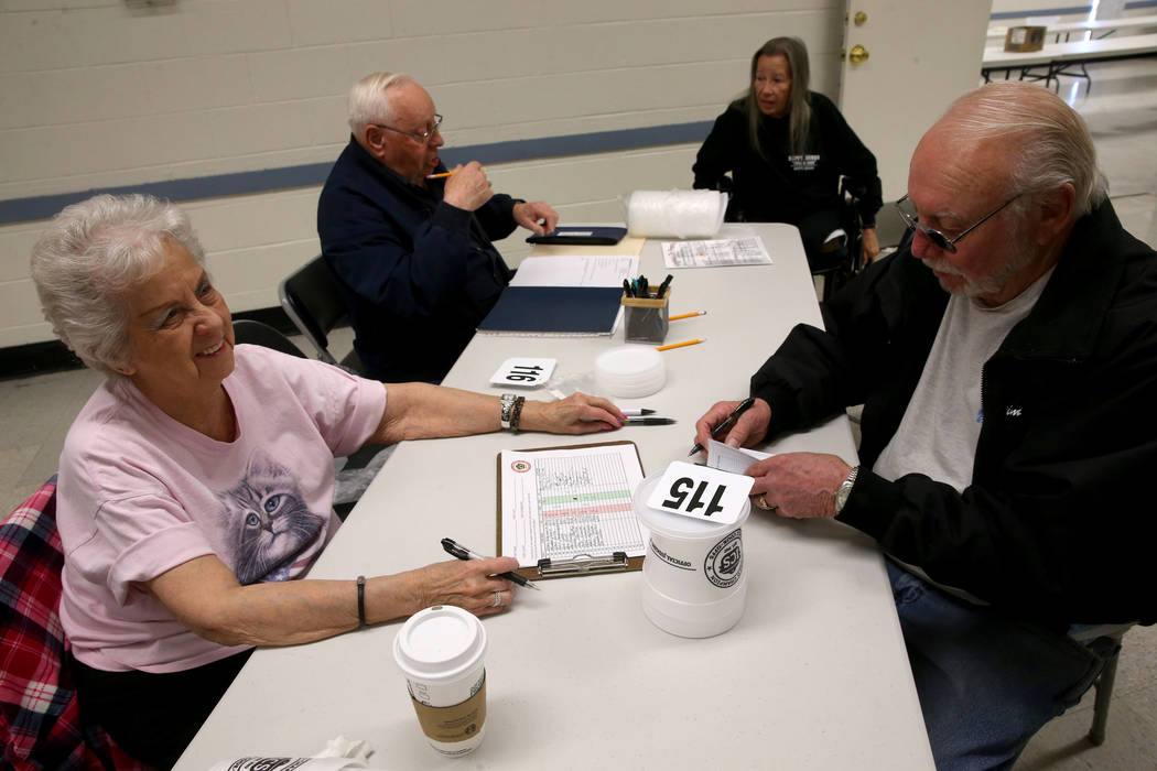 Bobbie Gaul of Pahrump, left, signs in Jim Watson of Nampa, Idaho to compete in the Nevada State Chili Cook-off at Petrack Park in Pahrump Sunday, March 17, 2019. (K.M. Cannon/Las Vegas Review-Jou ...