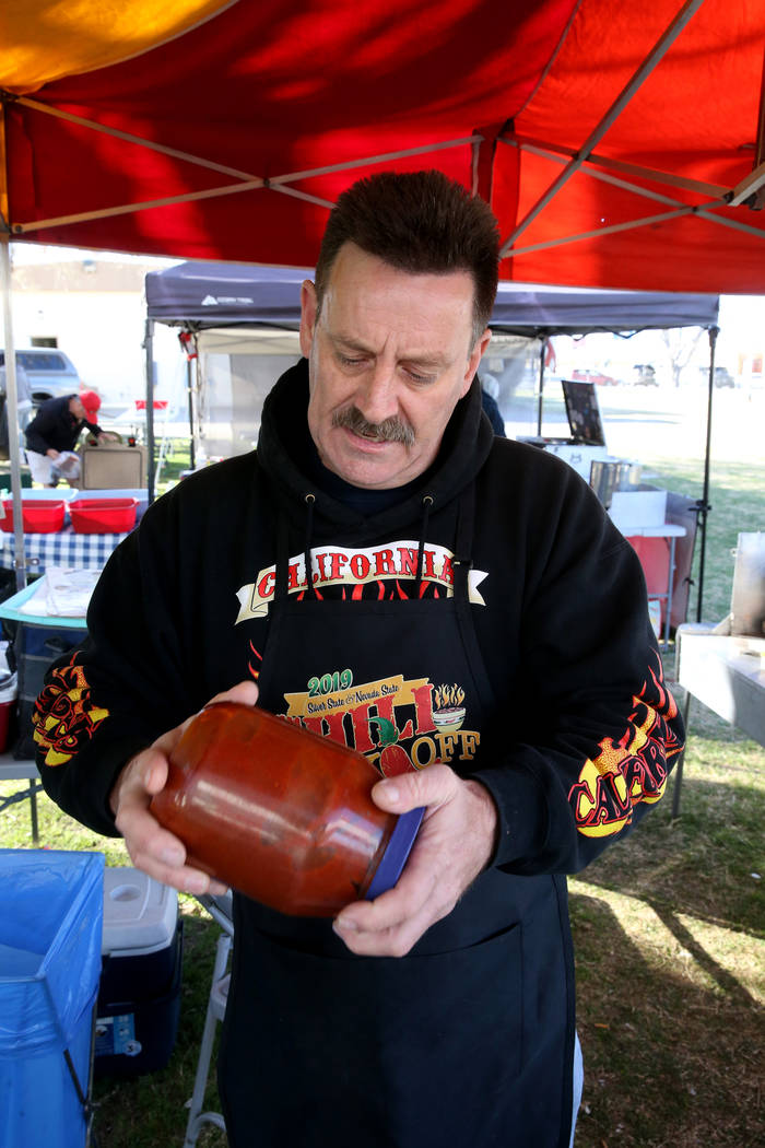 Tony Austin of San Bernardino, California, shakes his chili ingredients in his booth at the Nevada State Chili Cook-off at Petrack Park in Pahrump Sunday, March 17, 2019. (K.M. Cannon/Las Vegas Re ...