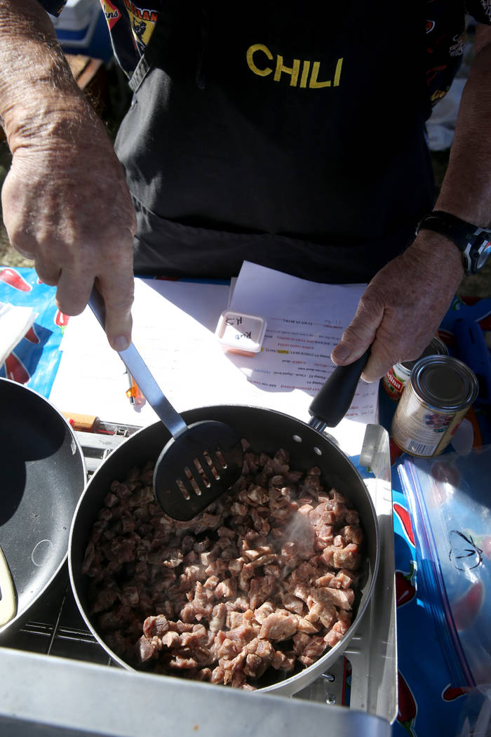 Clark McGee of Chino Hills, California, browns his chili meat in his booth at the Nevada State Chili Cook-off at Petrack Park in Pahrump Sunday, March 17, 2019. (K.M. Cannon/Las Vegas Review-Journ ...