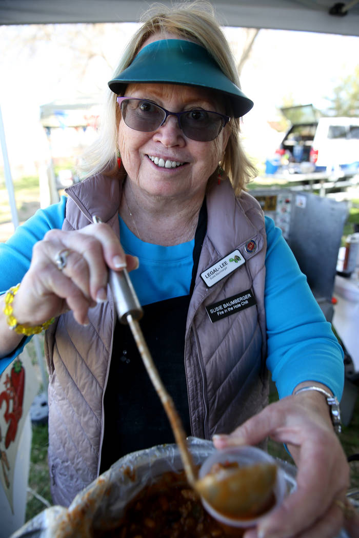 Susie Baumberger of Lancaster, California, offers a sample of her People's Choice chili at her booth during the Nevada State Chili Cook-off at Petrack Park in Pahrump Sunday, March 17, 2019. (K.M. ...