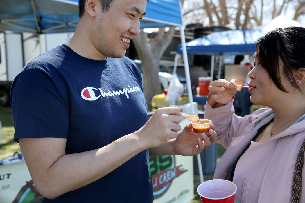 Jiefei Wang and his fiancee Jin Zhou of Buffalo, New York, sample People's Choice chili during the Nevada State Chili Cook-off at Petrack Park in Pahrump Sunday, March 17, 2019. (K.M. Cannon/Las V ...