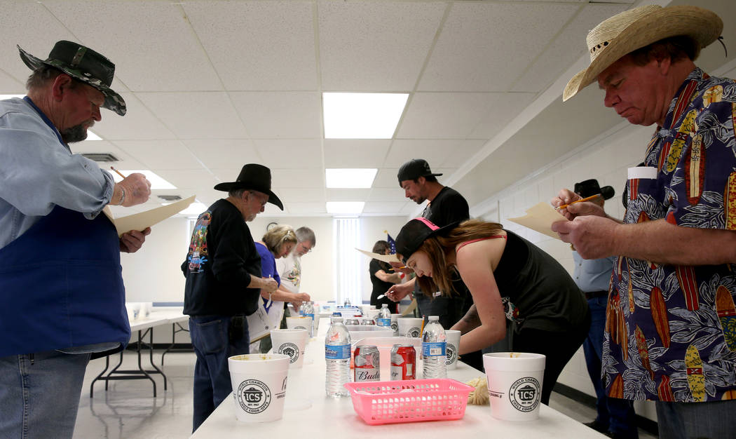 Judges, including Larry Snow, left, and Dan Wright, right, both of Pahrump, during the Homestyle category competition chili at the Nevada State Chili Cook-off at Petrack Park in Pahrump Sunday, Ma ...
