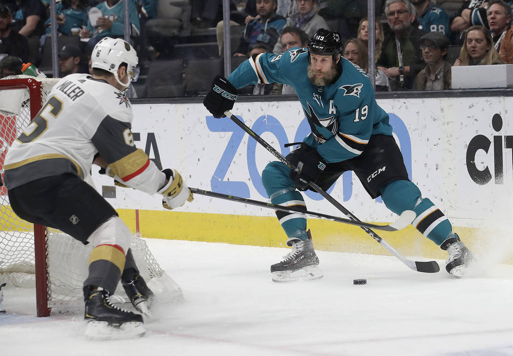 San Jose Sharks center Joe Thornton (19) skates with the puck against Vegas Golden Knights defenseman Colin Miller (6) during the first period of an NHL hockey game in San Jose, Calif., Monday, Ma ...
