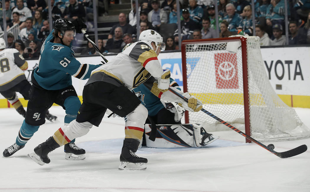 Vegas Golden Knights center Paul Stastny, center, shoots against San Jose Sharks defenseman Justin Braun (61) to score a goal during the second period of an NHL hockey game in San Jose, Calif., Mo ...
