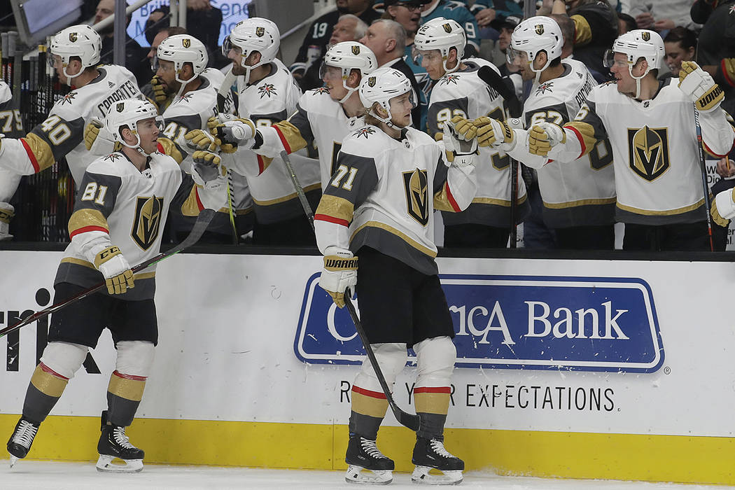 Vegas Golden Knights center William Karlsson (71) is congratulated by teammates after scoring a goal against the San Jose Sharks during the first period of an NHL hockey game in San Jose, Calif., ...
