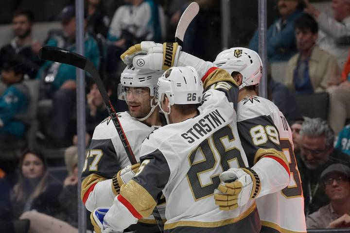 Vegas Golden Knights center Paul Stastny (26) is congratulated by teammates after scoring a goal against the San Jose Sharks during the second period of an NHL hockey game in San Jose, Calif., Mon ...